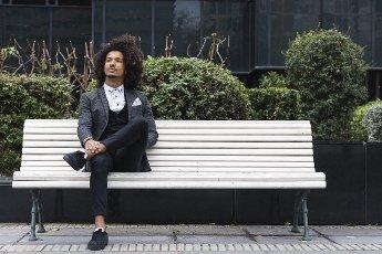 Contemplative male entrepreneur sitting on bench