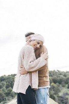 Smiling girlfriend embracing boyfriend
