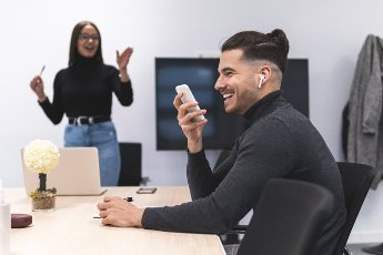 Smiling businessman talking on mobile phone during conference in office