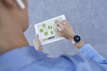 Businesswoman with smart watch using digital tablet
