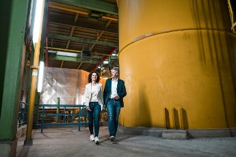 Male and female expertise walking at power station