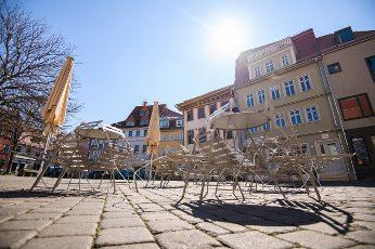 (200401) -- ERFURT (GERMANY), April 1, 2020 (Xinhua) -- Piled tables and chairs are seen outside a closed restaurant in Erfurt, central Germany, on April 1, 2020. Germany will extend the restrictions on social contacts to April 19 at the earliest, in a bid to contain the COVID-19 spreading, Chancellor Angela Merkel said following a video conference with minister-presidents of all 16 federal states. (Photo by Kevin Voigt/Xinhua)