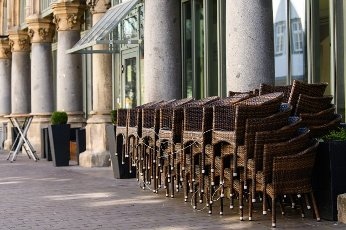 (200401) -- ERFURT (GERMANY), April 1, 2020 (Xinhua) -- Piled chairs are seen outside a closed restaurant in Erfurt, central Germany, on April 1, 2020. Germany will extend the restrictions on social contacts to April 19 at the earliest, in a bid to contain the COVID-19 spreading, Chancellor Angela Merkel said following a video conference with minister-presidents of all 16 federal states. (Photo by Kevin Voigt/Xinhua)