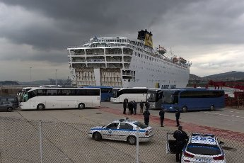 """(200403) -- PIRAEUS (GREECE), April 3, 2020 (Xinhua) -- Buses are seen to transport passengers, who tested negative for COVID-19, of the Greek ferry """"Eleftherios Venizelos,"""" in Piraeus, Greece, on April 3, 2020. The Greek ferry """"Eleftherios Venizelos"""" with 119 confirmed cases on board has docked at Piraeus port, as the Greek government started on Friday the transfer to the shore of 261 passengers who tested negative for the COVID-19, Greek national news agency AMNA reported. (Xinhua/Marios Lolos)"""