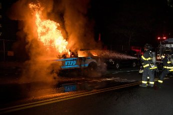 """(200531) -- NEW YORK, May 31, 2020 (Xinhua) -- Firefighters put out a fire on a SUV of New York police department during a protest over the death of George Floyd in the Brooklyn borough of New York, the United States, May 30, 2020. New York officials on Saturday denounced acts of violence in the city\'s protests over George Floyd\'s death, after about 300 protesters were arrested in days. Mayor Bill de Blasio said at a briefing that some protesters """"came with an agenda of violence and incitement,"""" and the city does not allow it to happen. (Photo by Michael Nagle\/Xinhua)"""