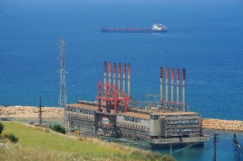 "(210515) -- BEIRUT, May 15, 2021 (Xinhua) -- The Turkish power ship Orhan Bey is seen in the port of Jiyeh in the Governorate of Mount Lebanon, Lebanon, on May 14, 2021. TO GO WITH ""Turkish company cuts electricity supply to Lebanon"" (Xinhua\/Bilal Jawich"