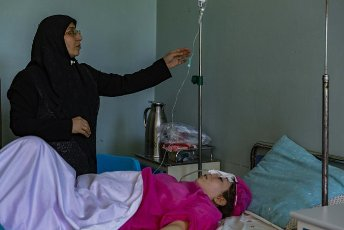 (210616) -- HERAT, June 16, 2021 (Xinhua) -- An injured woman receives medical treatment at a hospital in Herat, Afghanistan, June 16, 2021. Two women and a child were killed and 11 people wounded in a shooting in western Afghan province of Herat Tuesday night, an Interior Ministry official confirmed on Wednesday. (Photo by Elaha Sahel\/Xinhua