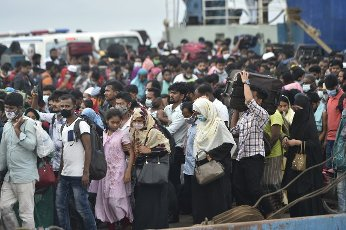 (210731) -- MUNSHIGANJ, July 31, 2021 (Xinhua) -- People get off a ferry at a terminal in Munshiganj on the outskirts of Dhaka, Bangladesh, on July 31, 2021. Thousands of people, mostly garment workers, Saturday used ferries and even walked to reach back to their places of employment in the industrial belts in and around Bangladesh capital Dhaka as the government decided to allow export-oriented factories to resume production on Aug. 1 amid the ongoing COVID-19 lockdown. (Xinhua