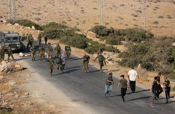 (210731) -- TUBAS, July 31, 2021 (Xinhua) -- Palestinian protesters clash with Israeli soldiers following a protest against the expanding of Jewish settlements at Tayasir checkpoint, east of the West Bank city of Tubas, July 31, 2021. (Photo by Ayman Nobani\/Xinhua